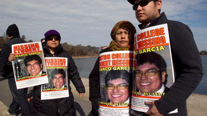 Feb. 27, 2012: Luzmila Garcia, of Newton, Mass., center right, mother of missing Boston College student Franco Garcia, displays a placard of her son along with Franco's aunt Carmen Espinoza, left, and his cousin Pablo Marchena, right, at the Chestnut Hill Reservoir where Mass. state police are searching the water for the missing student, in Boston. Garcia, 21, has not been seen since early Wednesday, at a bar popular with Boston College students near campus.