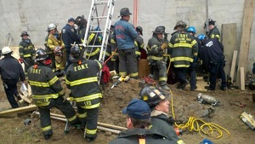 March 2: New York firefighters work to rescue a man trapped in a structural collapse in Harlem, New York.