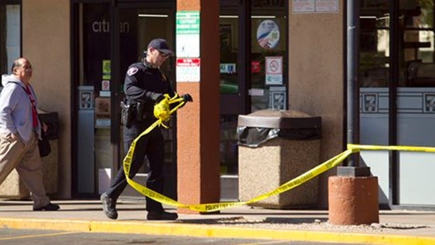 March 3, 2012: Tempe police officer E. Hutchinson secures the scene at the Clubhouse Music Venue in Tempe, Ariz.