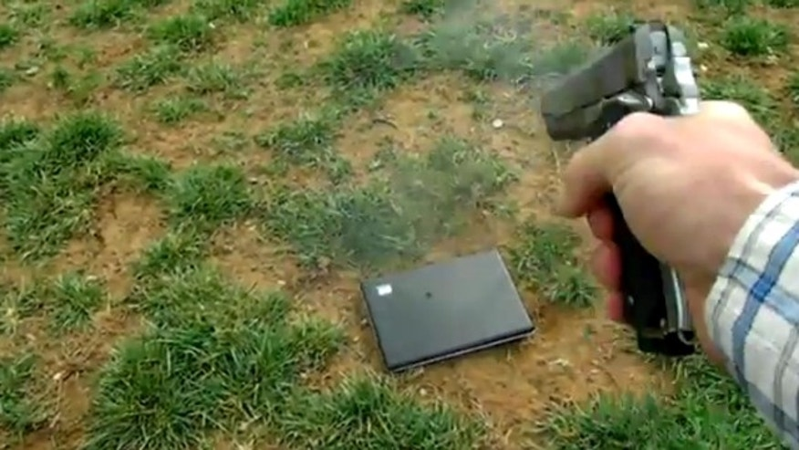 Tommy Jordan puts his daughter's laptop out of commission in this image taken from a video he posted online.