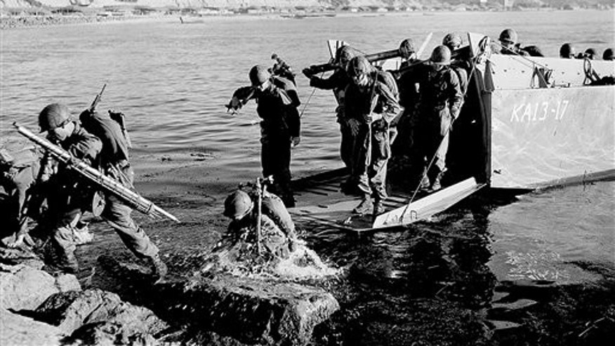 FILE - Troops of the First U.S. Cavalry Division land ashore at Pohang on the east coast of Korea during the Korean War.