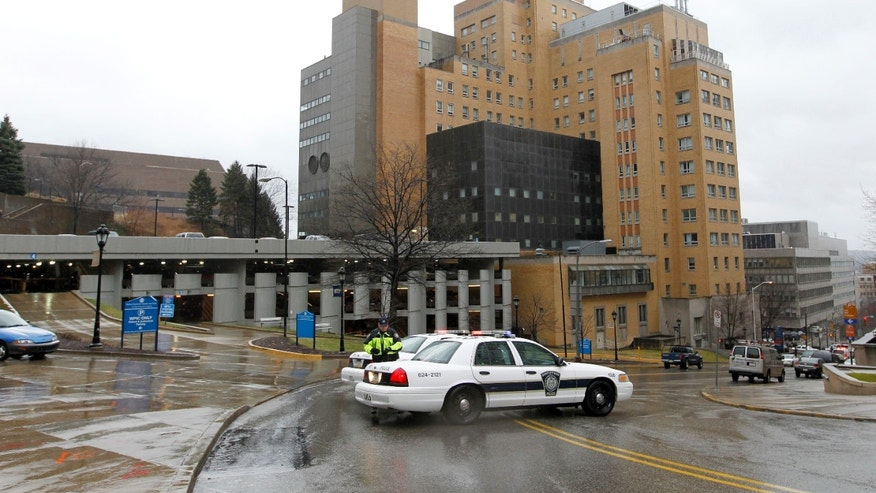 March 8, 2012: Police block the rear entrance to the Western Psychiatric Institute and Clinic on the University of Pittsburgh campus after a shooting.