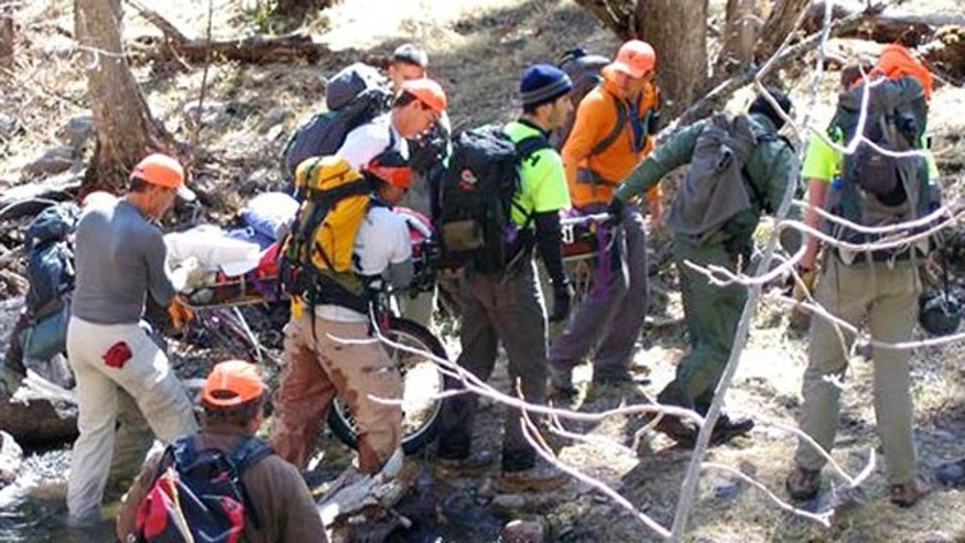 March 7, 2012: This image provided by David Kuthe shows missing hiker Margaret Page being rescued inside the Gila National Forest, N.M.