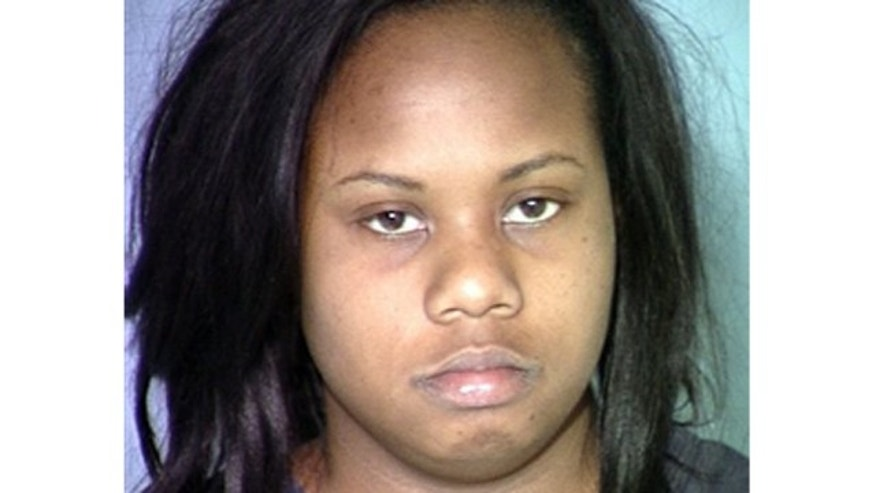 This image provided by the Las Vegas Metropolitan Police Department shows Danielle Yvonne Slaughter, who is accused  of stabbing her 6-year-old daughter to death with scissors.