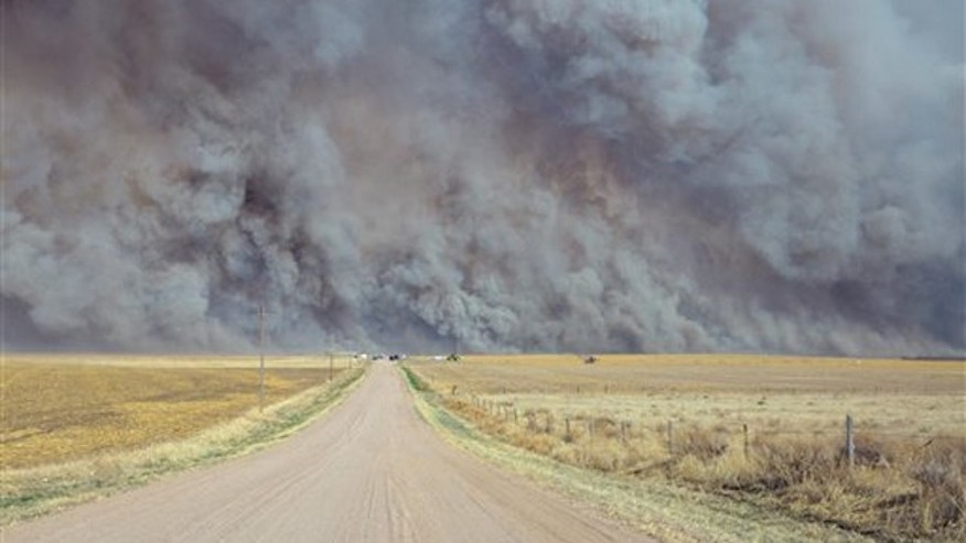 March 18, 2012: A wildfire sends up a huge wall of smoke, forcing authorities to temporarily close a section of U.S. Highway 34 east of Yuma County, Colo., when the fire filled the skies with so much smoke that firefighters couldn't see the flames.