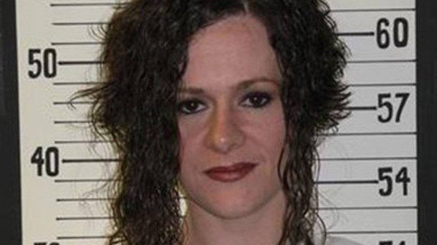 This 2009 photo provided by the Tennessee Department of Correction shows Christa Gail Pike. Authorities in Tennessee say two men, including a former prison guard, have been arrested in a plot to break out Tennessee's lone female death row inmate, Christa Gail Pike.