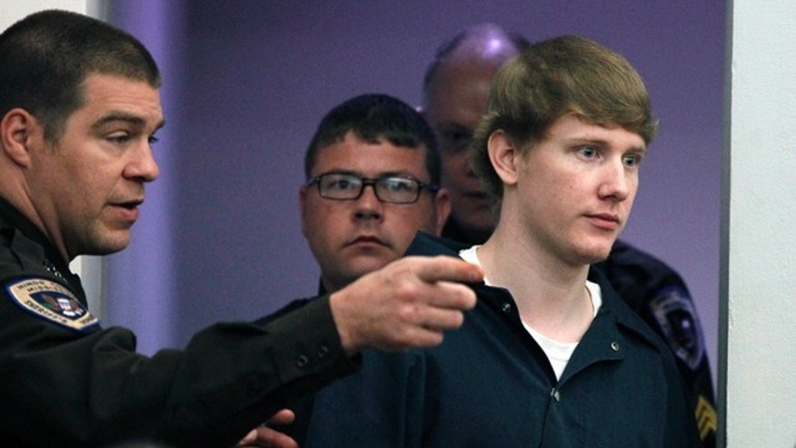 March 21, 2012: A Hinds County Sheriff's Department deputy directs Deryl Dedmon, 19,  who is charged with capital murder in the June 2011 death of 47-year-old James Craig Anderson in Jackson, to a seat in a Hinds County court room prior to pleading guilty to murder and committing a hate crime.