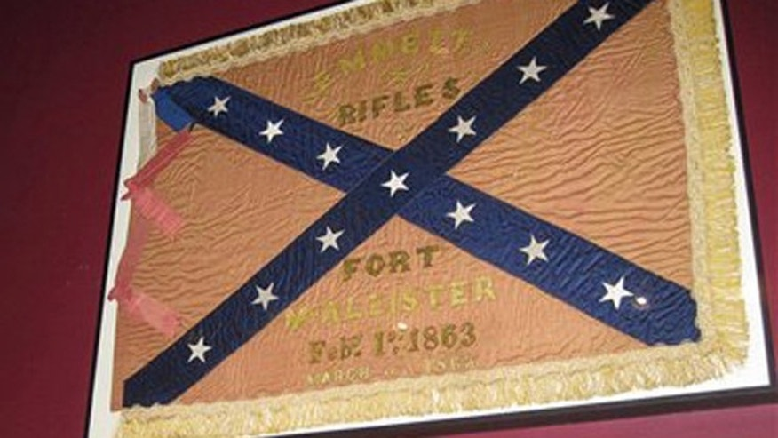March 21, 2012: In this photo, a Confederate unit flag that belonged to the Emmett Rifles, a Georgia-based company during the Civil War, hangs at Fort McAllister state park in Richmond, Ga., 148 years after the fort fell to Gen. William T. Shermans army.