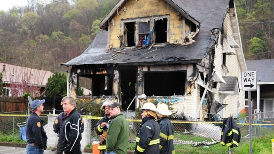 Mar. 24, 2012: Mayor Danny Jones and Charleston, WVa., firefighters look over the scene of a house fire.