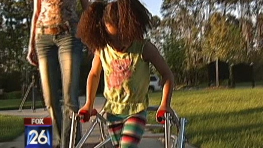 Lakay Roberts, 5, has been using a walker at Kings Manor Elementary School in Houston for the past two years.