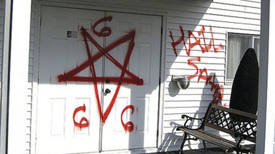 "Bright red spray-paint was used to write ""Hail Satan"" and ""666""outside walls of Gospel Light Missionary Baptist Church."