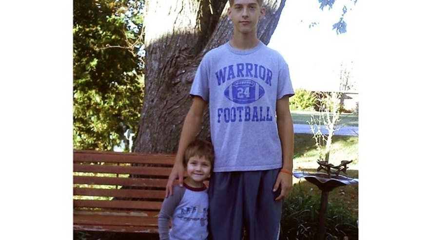 This 2011 photo provided by Joey Dawson shows Dawson and his nephew Caleb Linn.