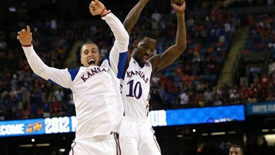 Mar. 31, 2012: Kansas guard Tyshawn Taylor (10) celebrates with Kansas guard Christian Garrett at the end of an NCAA Final Four semifinal college basketball tournament game against Ohio State.