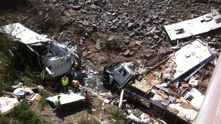 April 1, 2012: Officials work the scene of a Minnesota-bound motor home on Sunday in a ravine off Interstate 35 in northeast Kansas.