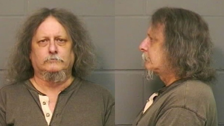 Raymond Foley, 59, is accused of urinating on the office chairs of fellow office workers in West Des Moines has surrendered to police.