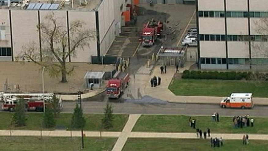 Authorities say an explosion involving a battery injured two at a General Motors research facility in suburban Detroit.