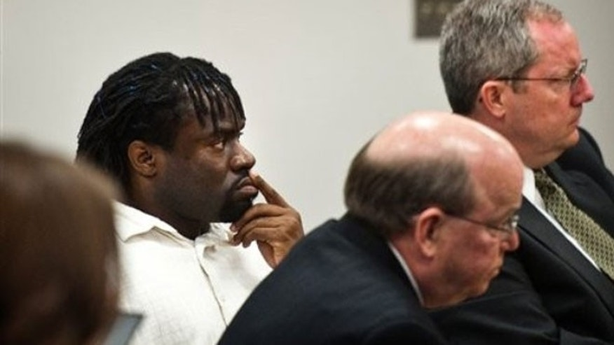 April 20, 2012: Defendant Marcus Robinson, left, sits with his lawyers during the final day of his hearing under the Racial Justice Act at the Cumberland County Courthouse in Fayetteville, N.C.