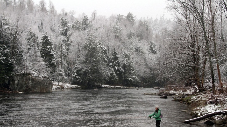 April 22: A woman fishes on the West Branch of the AuSable River in Wilmington, N.Y.