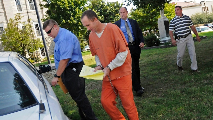 Aug. 23, 2011: Clay Waller, center, is escorted to a police vehicle after a court hearing at the Cape Girardeau County Courthouse in Jackson, Mo. Waller, 41, was charged April 23, 2012 with first-degree murder in the death of his estranged wife Jacque Waller.