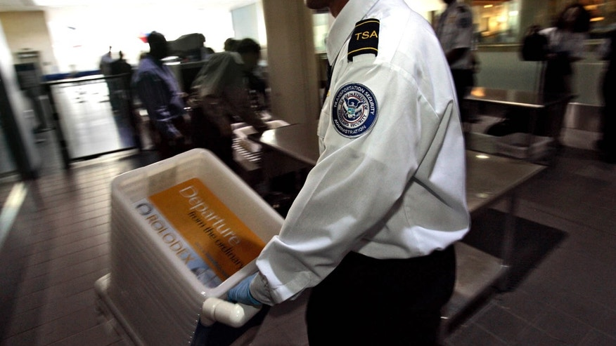 FILE - This Jan. 10, 2007 file photo shows Transportation Security Officer Juan Morales at the Los Angeles International Airport in Los Angeles.