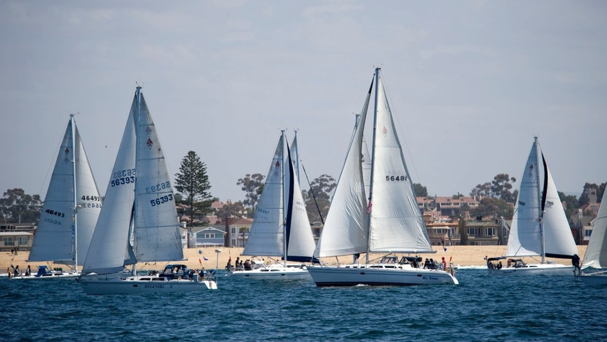 April 27, 2012: Boats tack for position before the start of the Newport Ocean Sailing Association's Newport to Ensenada yacht race.