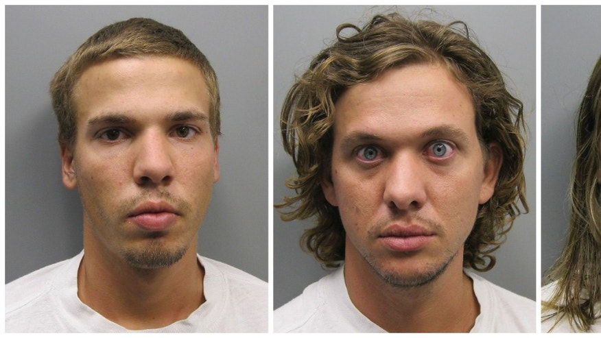 FILE - This photo combo made from file photos provided Wednesday, Aug. 10, 2011 by the Pueblo County Sherif's Office shows, from left, Ryan Edward Dougherty, 21, Dylan Stanley-Dougherty, 26, and Lee Grace Dougherty, 29.