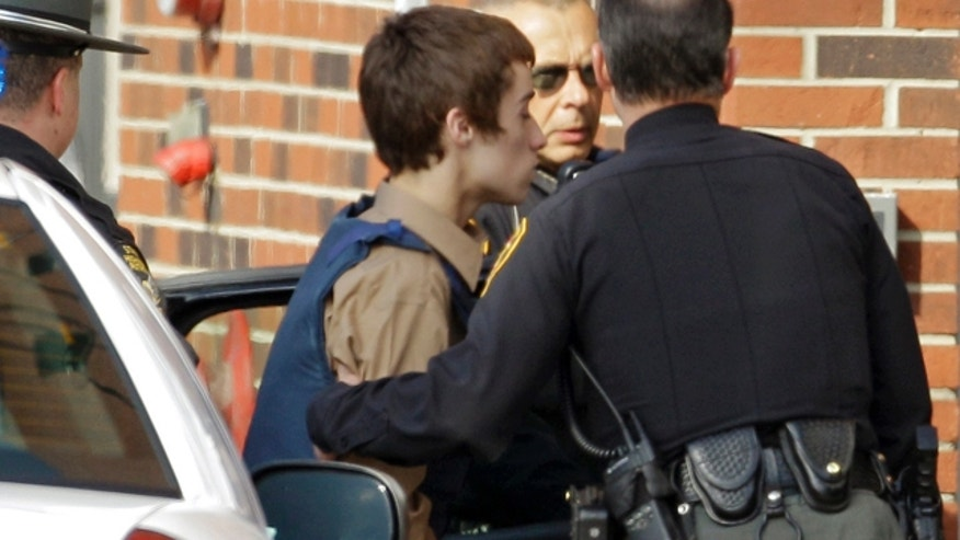 Feb. 28, 2012: T.J. Lane, a suspect in Monday's shooting of five students at Chardon High School is taken into juvenile court by Geauga County deputies in Chardon, Ohio.