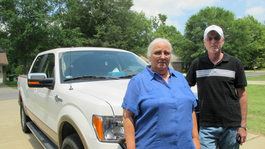 May 2, 2012: Sharon and William Jones pose in front of the pickup truck they bought with some of their lottery winnings outside their home.