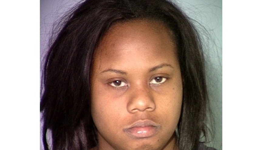 """March 12: Photo released by Las Vegas Metropolitan Police Department shows Danielle Yvonne Slaughter, from Las Vegas. Slaughter pleaded not guilty by reason of insanity May 3, 2012 to killing her 6-year-old daughter with scissors after thinking she heard the girl speak and laugh in what she later told police was an """"evil voice."""""""