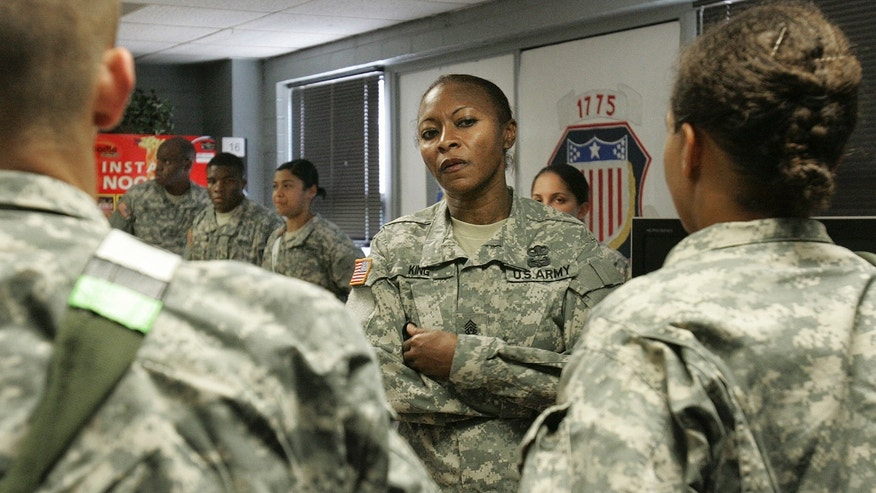 Sept. 15, 2009: Command Sgt. Maj. Teresa King, 48, queries young soldiers during an inspection of the barracks at Fort Jackson, S.C.
