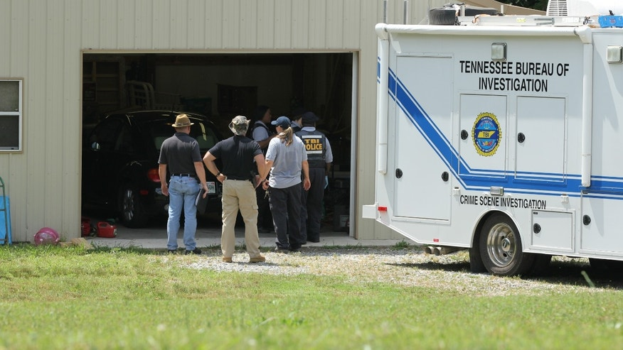 May 6, 2012: Tennessee Bureau of Investigation agents inspect the home and garage of a woman and her three young daughters who authorities say were abducted near Whiteville, Tenn.