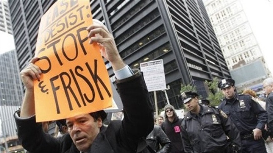 October 2011: New York City police officers follow an anti-stop and frisk march near the former Occupy Wall Street encampment in lower Manhattan.  (AP Photo/Mary Altaffer)