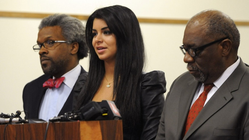 April, 11: Former Miss USA Rima Fakih, center, stands before the court with city attorney Todd Russell Perkins, left, and her attorney Otis Culpepper, for her drunken driving case in Highland Park, Mich.