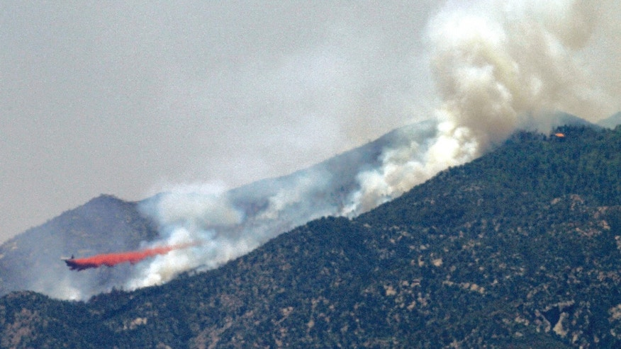 May 14, 2012: An air tanker drops retardant on a fire near Crown King, Ariz.