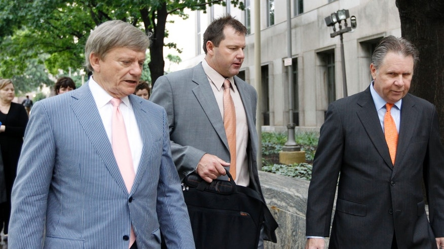 May 15: Former Major League Baseball pitcher Roger Clemens, center, and attorney Rusty Hardin, left, arrive at federal court in Washington for Clemens perjury trial.