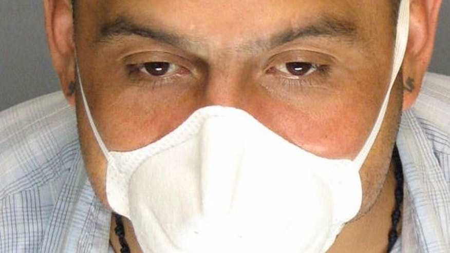 In this undated photo supplied by the San Joaquin County District Attorney's office, Armando Rodriguez is seen wearing a protective mask.