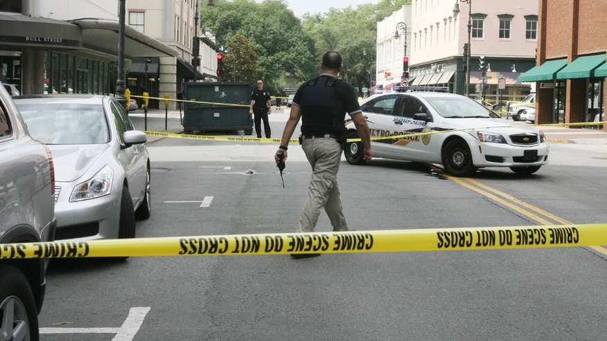 May 17, 2012: Bull and Broughton street in Savannah, Ga., is blocked off as police search for a gunman.