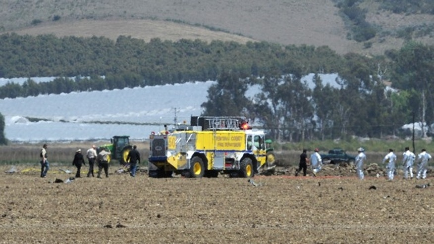 May 18, 2012: Ventura County firefighters and other emergency response personnel work amidst the wreckage of a Hawker Hunter, a single-seat fighter/ground attack monoplane, that crashed about 12:15 p.m. in a field off Broome Ranch Road between CSU Channel Islands in Camarillo and Point Mugu, Calif.