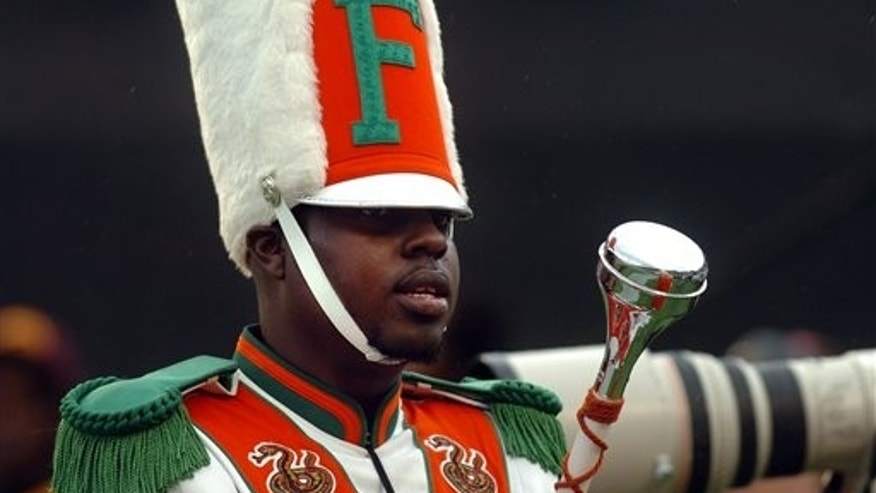 In this Nov. 19, 2011 file photo, Robert Champion, a drum major in Florida A&M University's Marching 100 band, performs during halftime of a football game in Orlando, Fla. Champion, who died after being hazed on a bus, asked to go through the ordeal because it was seen as an honor, said defendant Jonathan Boyce in a deposition released Wednesday, May 23, 2012.
