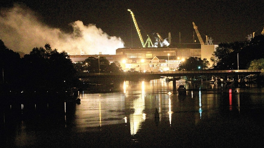 May 23, 2012: Smoke rises from a dry dock as fire crews respond Wednesday, to a fire on the USS Miami.