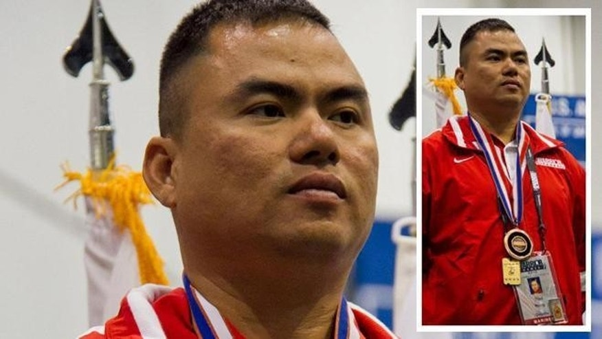 Sgt. Than Naing after winning a medal for an archery competition during the 2012 Warrior games.