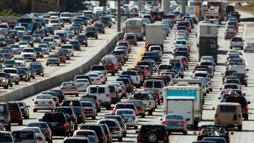 More Americans will hit the road this holiday weekend than a year ago.