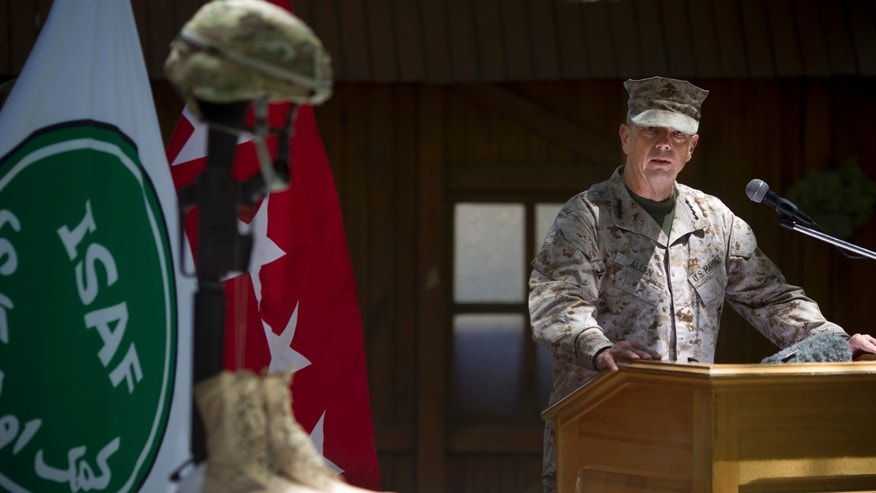 May 28, 2012: Gen. John Allen, the top U.S. commander in Afghanistan, observes Memorial Day by reading a letter written by an American soldier to his family before he died earlier this year, at the ISAF headquarters in Kabul, Afghanistan.