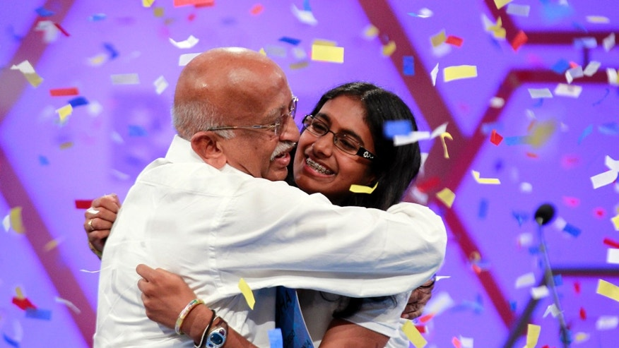 May 31, 2012: Snigdha Nandipati, 14, of San Diego, reacts with her grandfather from India, after winning the National Spelling Bee in Oxon Hill, Md.