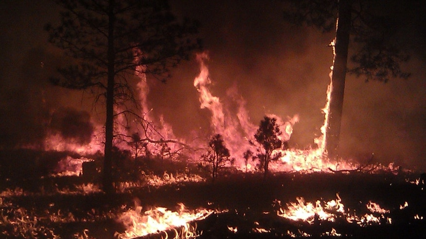 May 29, 2012: Fire officials said the massive blaze in the Gila National Forest is seen from Cliff, N.M. has burned more than 265 square miles has become the largest fire in New Mexico history.