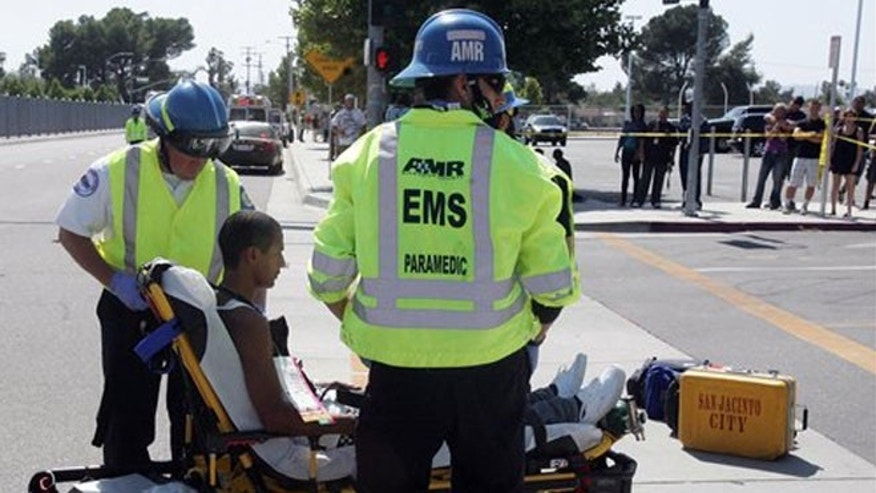 May 30, 2012: A Hemet High student is tended to by Cal Fire/Riverside County Paramedics after a truck struck eight people in a crosswalk in front of the school in Hemet, Calif.