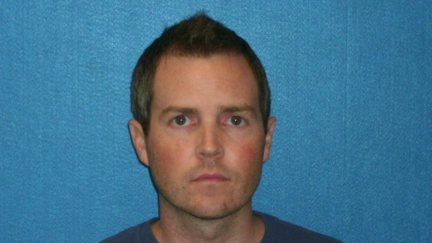 This photo provided by the Grapevine Police Department shows John McDaniel.