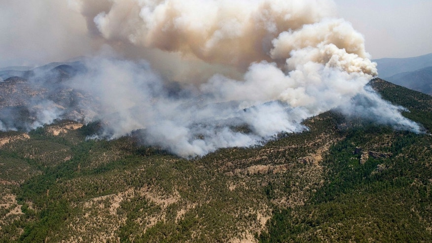 June 2, 2012: A large cloud of smoke rises from a fire in the Gila National Forest in New Mexico. The Whitewater-Baldy Complex fire has scorched more than 377 square miles.