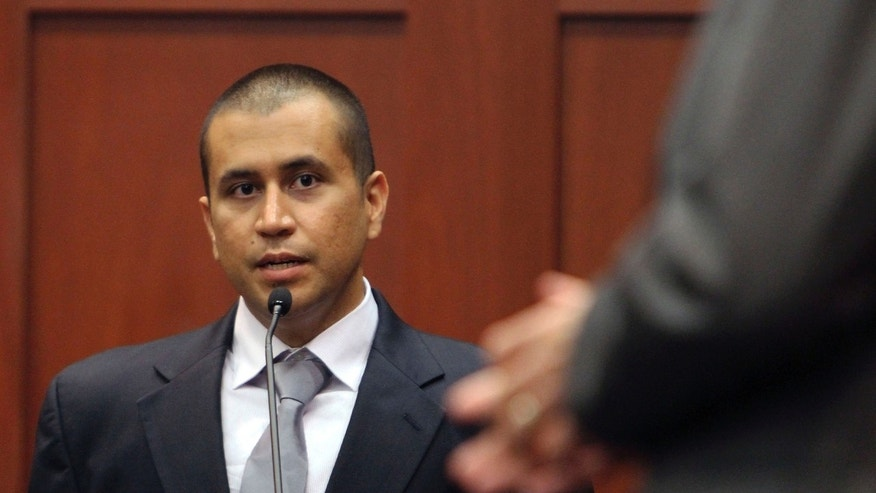 FILE - In this April 20, 2012 file photo, George Zimmerman, left, answers a question from attorney Mark O'Mara during a bond hearing in Sanford, Fla. A judge on Friday, June 1, 2012 revoked Zimmerman's bond and ordered him returned to jail within 48 hours. Circuit Judge Kenneth Lester said Zimmerman misled the court about how much money he had available when his bond was set for $150,000 in April. Prosecutors claim Zimmerman had $135,000 available that had been raised by a website he set up.  (AP Photo/Orlando Sentinel, Gary W. Green, Pool, File)
