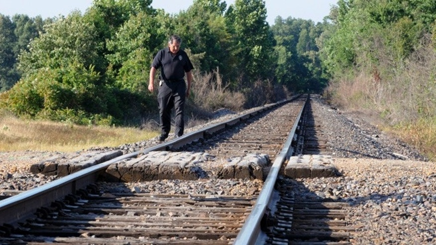 June 5: Union Pacific Railroad Special Agent Steve Ray looks for debris along a rail line just north of Poplar Bluff, Mo., after two teenagers were killed and another injured when their vehicle was struck by an Amtrak train just after midnight.